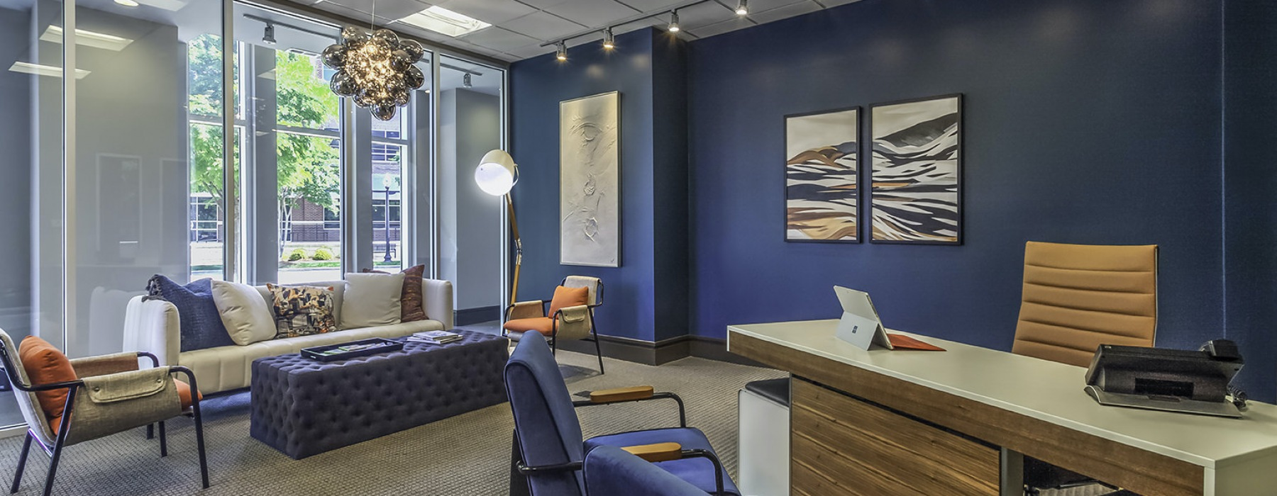 Leasing office with dark blue wall and comfortable modern furniture