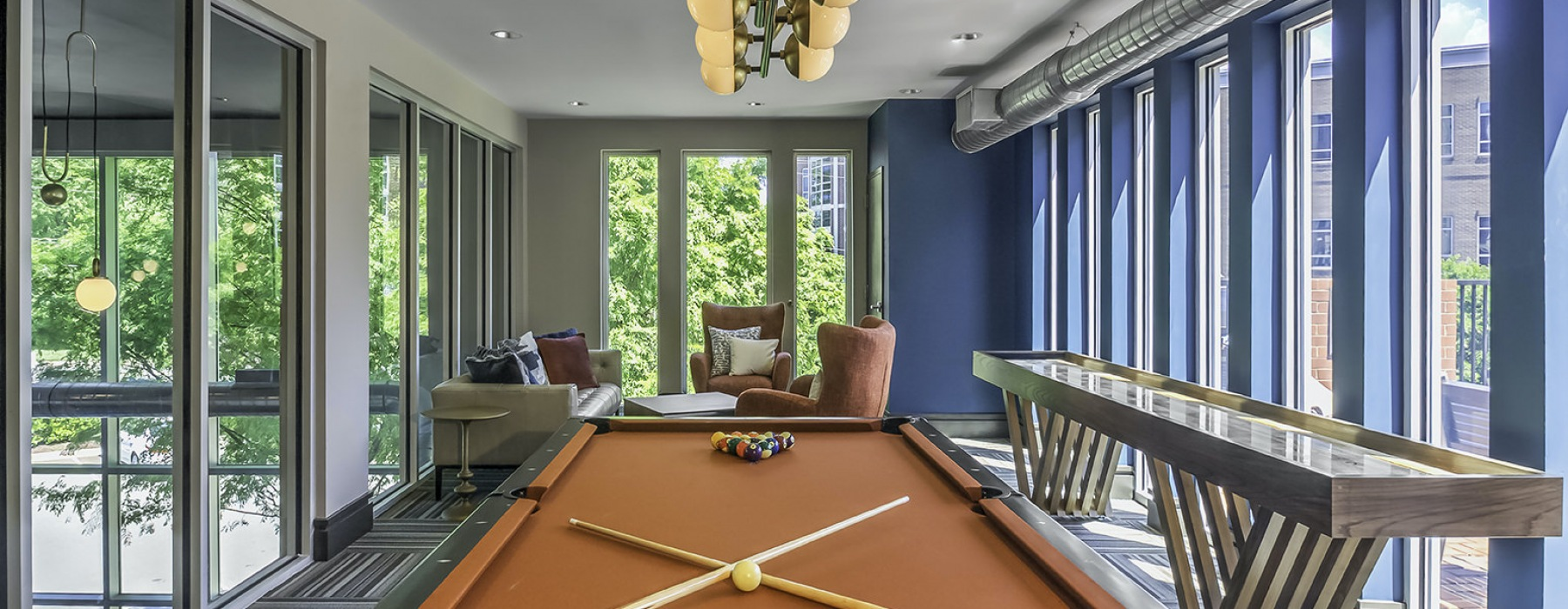 Pool table in resident lounge with industrial style